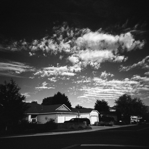 Clouds over my house. I held a medium red filter in front of the lens for this shot to give the sky more contrast.