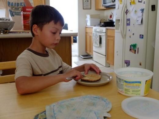 Robert making his after school snack
