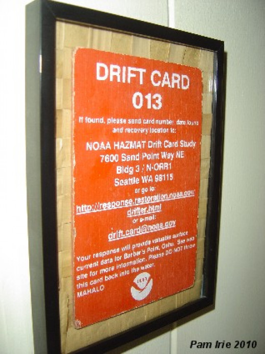 Actual drift card found by my daughter New Years Day on the beach several years back. Lauhala remnant background in inexpensive black frame.