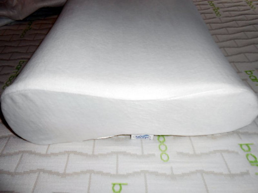 A photo of one of our new cool memory foam Sleep Innovation pillow on top of our mattress topper.