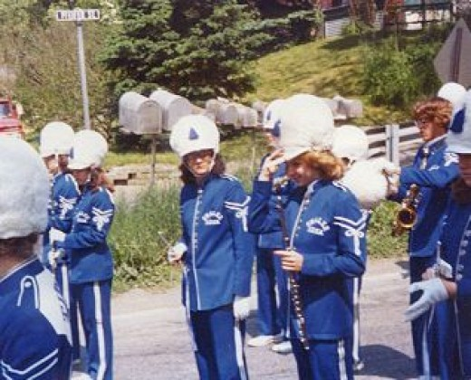 My sister with bandmates. Notice her helmet is different from my shakos!