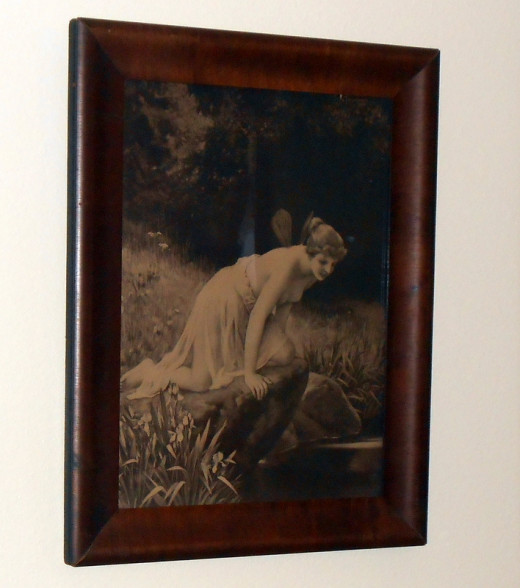 My favorite vintage lithograph in this antique wooden frame hangs with a Hercules Hook.
