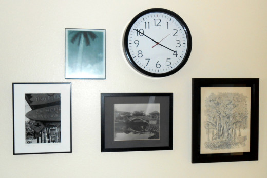 All four pieces of wall art and the wall clock each use one Hercules Hook.