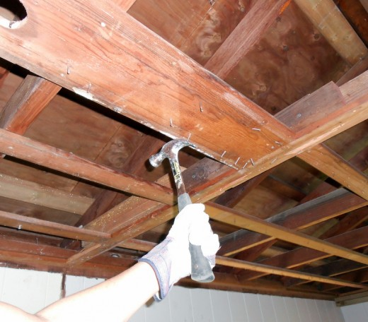 Every nail and staple in the ceiling framework must be removed before the new drywall goes up.