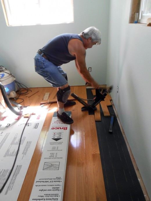 Hubby is installing the new hardwood flooring.