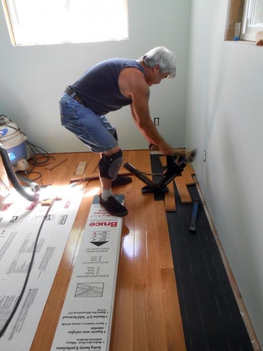 Hubby is installing the new hardwood flooring.