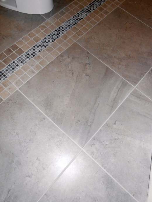 Bathroom floor tile work completed.
