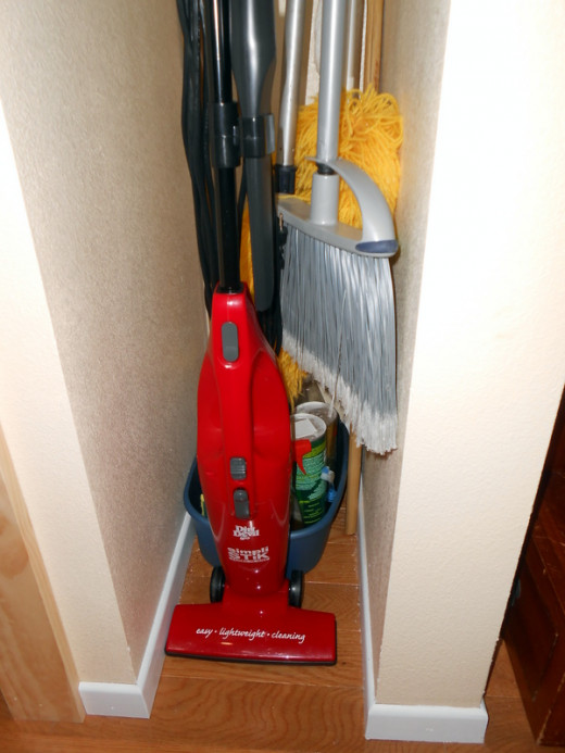 "It's spacious! This handy vacuum fits into a tiny 11"" wide cleaning closet. :)"