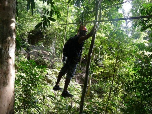 The first step in the canopy adventure, walking on a steel cable about 25m long