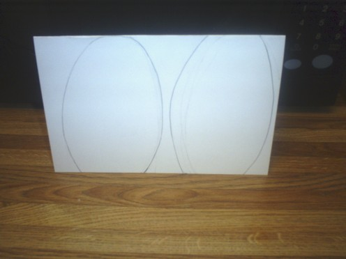 Fit two egg shapes onto a folded card.