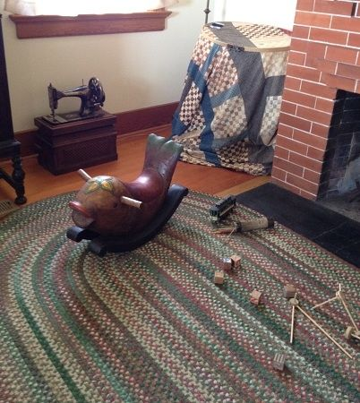 The caretaker's living room with rocking whale, tinker toys and an old time portable sewing machine