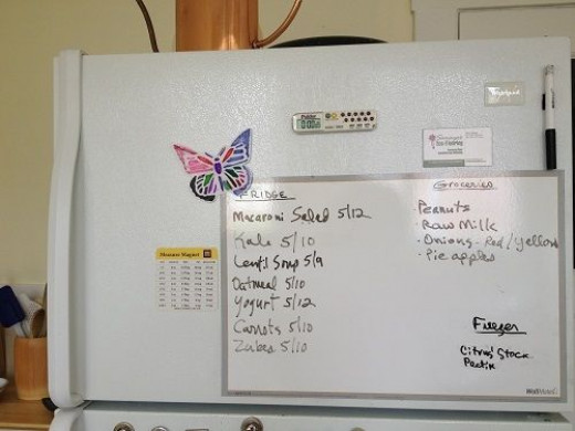 Peel and stick dry erase board on our fridge