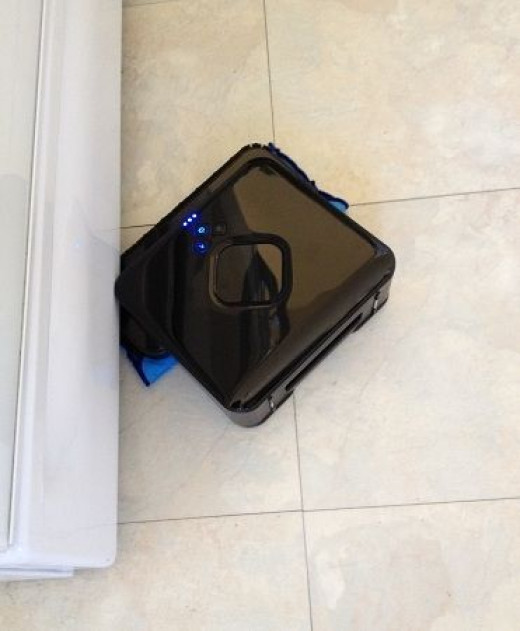 Mint Robotic Floor Cleaner cleaning along stove edge
