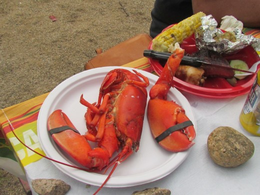 Whole lobsters were served with steak, corn on the cob and a variety of other delectable dishes.