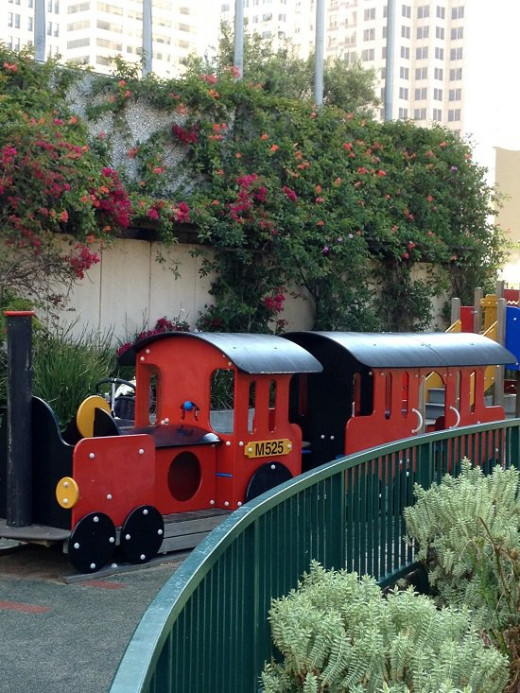 A colorful train resides in one of the small parks near downtown where children can play while parents take a break from the tour and enjoy the views