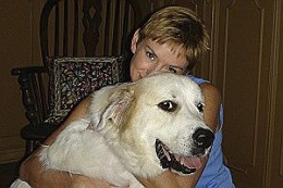 Great Pyrenees Harry Snoodles with his TGPR foster mom