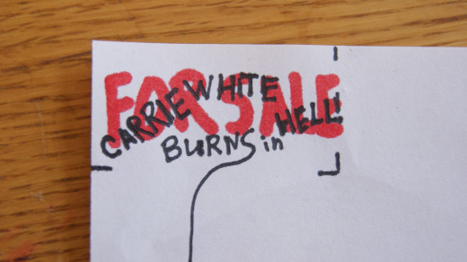 "Mark a 5cm by 2.5cm rectangle on a piece of paper and write the words ""FOR SALE"" in red. Then ""CARRIE WHITE BURNS IN HELL!!"" over top in black. Cut"