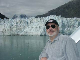 This photo of my husband, taken on the balcony of our room on the ship, will give you some idea of the size of the glaciers.  The ship was over 1 mile away from the glacier you see in the background.