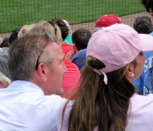 Rams head coach, Steve Spagnuola, was seen at the ballpark giving an autograph to a young fan.