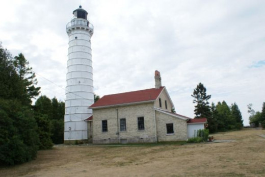 A side view of the keepers house and lighthouse tower.