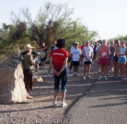 Kaity Bayne sings the anthem through a megaphone at Sabino Canyon Sunset Run in 2006