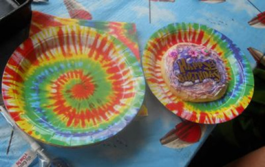 Use tie dye party plates and napkins as a decoration. Note the cookie.