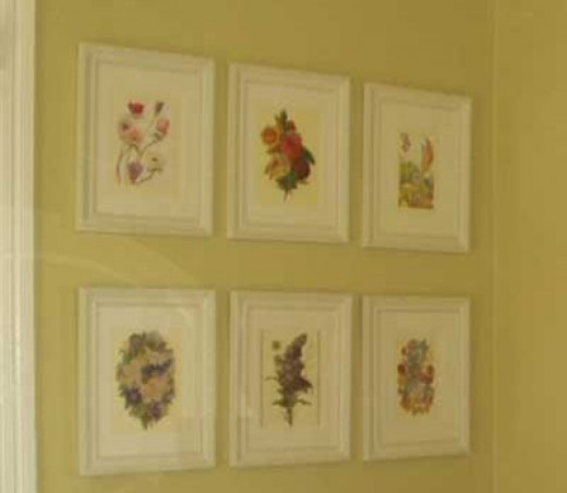 The framed floral prints on the wall above the bench make a beautiful display.