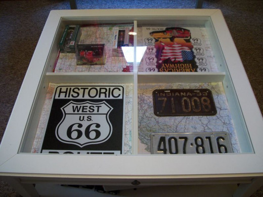 See the road map background? I think this was an inspired idea! Vicky added collectible trucks, old license plates, and Route 66 tin signs to her shadow box.