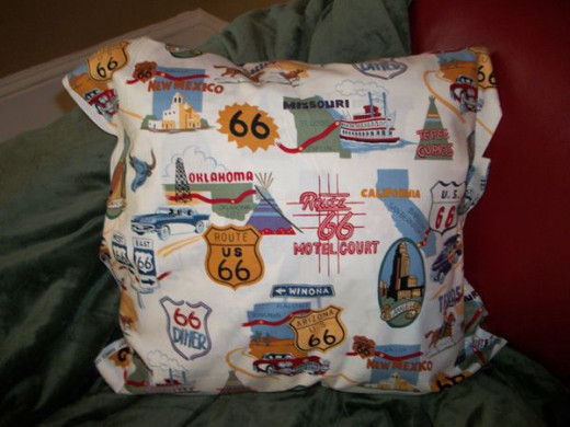 For an accent, she covered this throw pillow with Route 66 fabric.