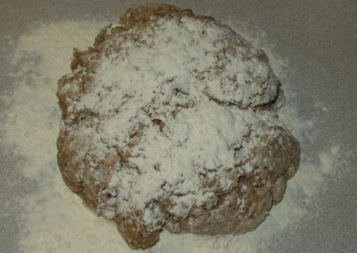 Step 4: Turn dough onto floured counter, knead in more bread flour until smooth.