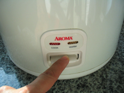 "After some time, the rice cooker may think that the batter is done and will automatically stop cooking and switch to the ""warm"" (or ""off"") setting. Check the rice cooker every now and then and put it back on ""cook"" if necessary."