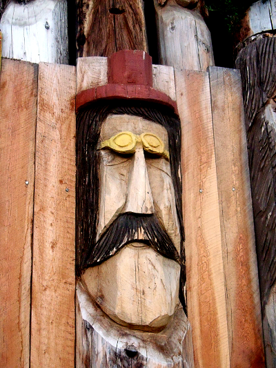 Chainsaw Wood Carving Of Man Wearing Glasses   Copyright © 2013 C. Johnson, Home Of A Thousand Faces, Radium BC. All Rights Reserved