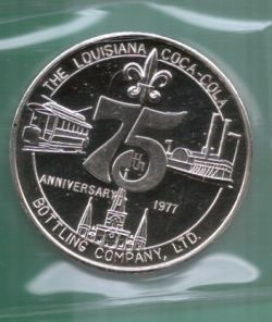 A Silver Coca-Cola round representing the New Orleans Coca-Cola Bottling Company for the 75th Anniversary celebration
