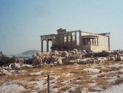 ...and the Erechtheion, an oddly-shaped temple built to enclose several sacred objects on the Acropolis, on the left.