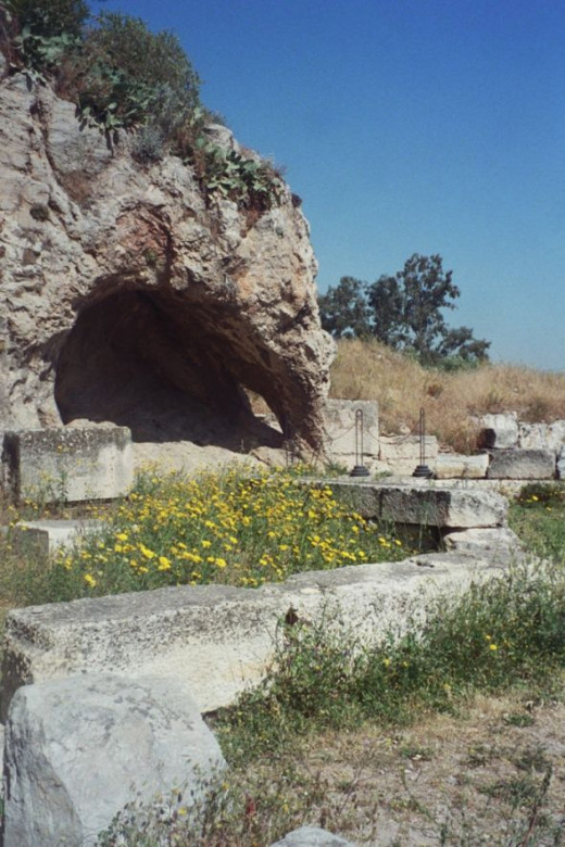 In the foreground, a temple to Hades. In the background, the Grotto where some sort of passion play took place celebrating Persephone's return. See the hole in the side of the cave? It's invisible from every angle but this one. It would have been eas