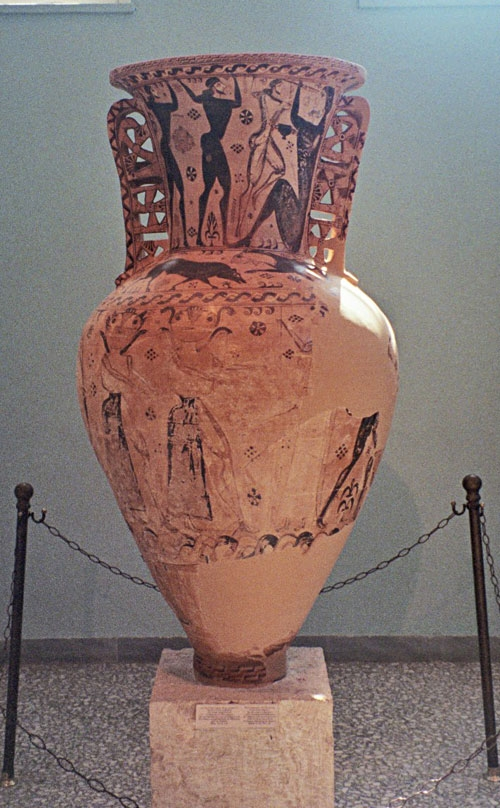 Massive Proto-Attic (that means early) Amphora, c. 670 BCE. The neck shows Odysseus and his sailors blinding the cyclops Polyphemus. Below, rather faded, are two Gorgons, Medusa's sisters, chasing Perseus (all you can see are his legs.) The figure in