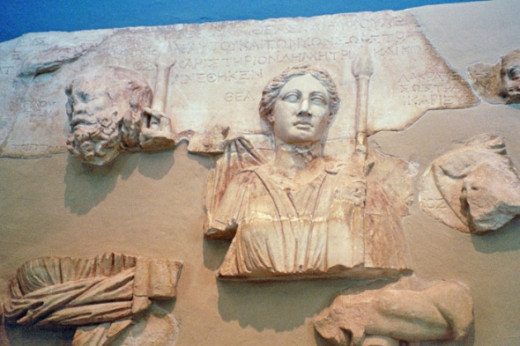 "Fragments of a large sculpture of the divinities of Eleusis commissioned by one Lakrateides in 97 BCE. ""Thea"" next to the goddess' head means, simply, ""Goddess."" These are Hades and Persephone in their aspect as king and queen of the underworld."
