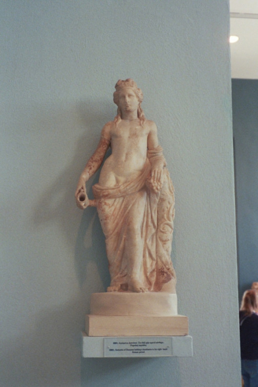 Roman figure of Dionysos, god of wine, had connections to the harvest-related festival of Eleusis. His inhibition-loosening cult was a rare outlet for women in a repressive culture. He was derided as somewhat effeminate. Then as now, that had an odd