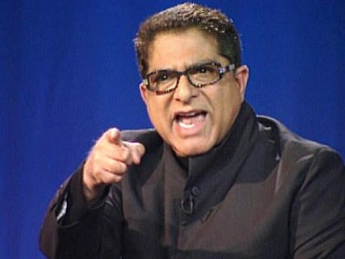 "Deepak Chopra gestures during the ""Nightline Face-Off"" on the existence of Satan. Chopra is seen on stage at the Mars Hill Church in Seattle.(ABC News)"