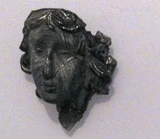Lady painted with mica. Made from mold created from the face of an ornament