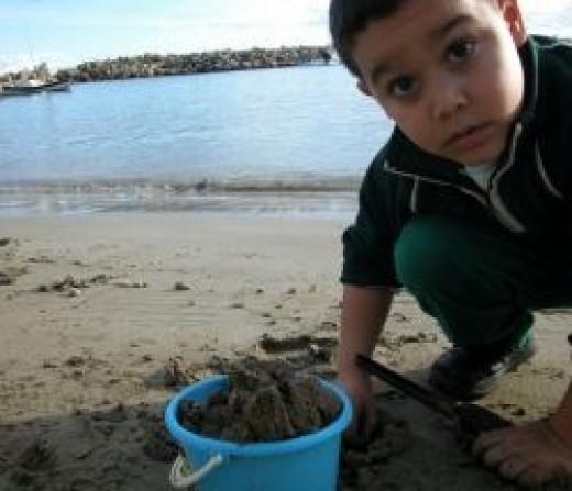 Child on Beach - Copyright Jupiter Images Corporation