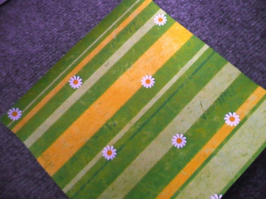 12x12 striped scrapbook paper in similar colours to Bella's cake
