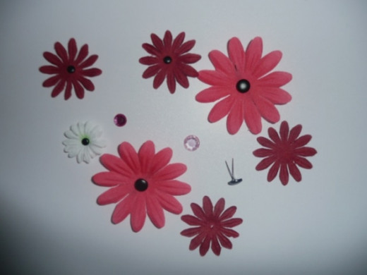 Pink and burgundy Gerbera daisy fabric flowers, plus one white daisy, black brads and pink rhinestones