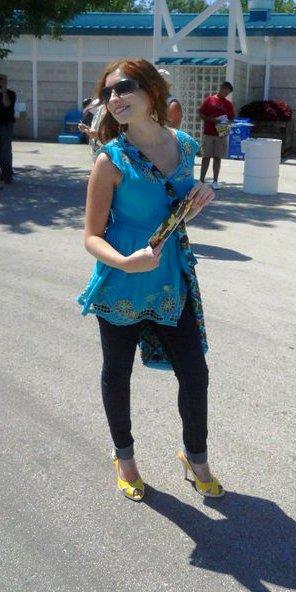 Enjoying the summer sun in heels with matching purse.