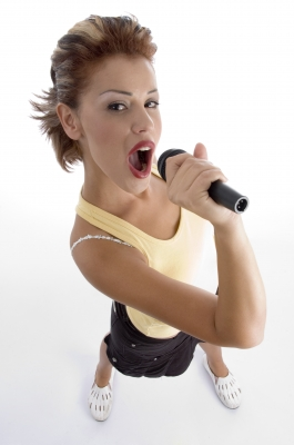 How you hold and use the microphone can affect your singing voice and sound quality.