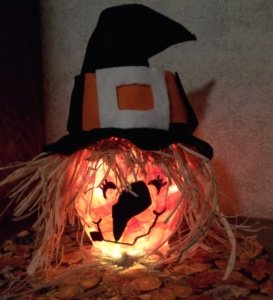 craft-witch-in-black-hat-lighted
