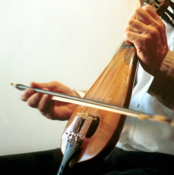 The lyra is a pear-shaped, three-stringed bowed musical instrument, central to the traditional music of the Greek islands.