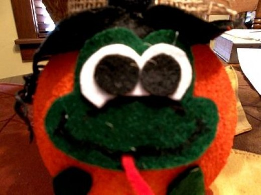 green-face-and-legs-on orange-ball-body