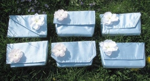 blue satin bridesmaid clutches