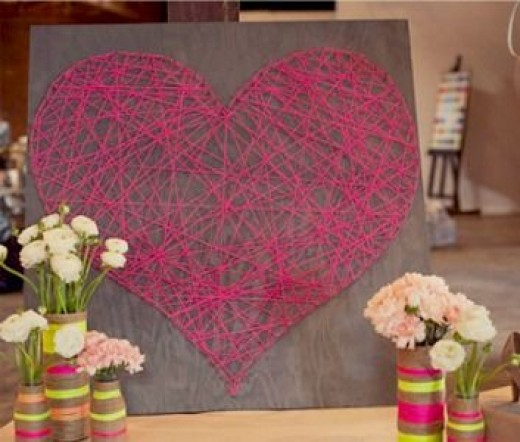 string red heart wall art